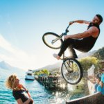 Flipping into the Queenstown Lake on his bike