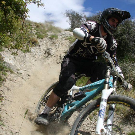 Downhill mountain biker at Dirt Park track, near Queenstown