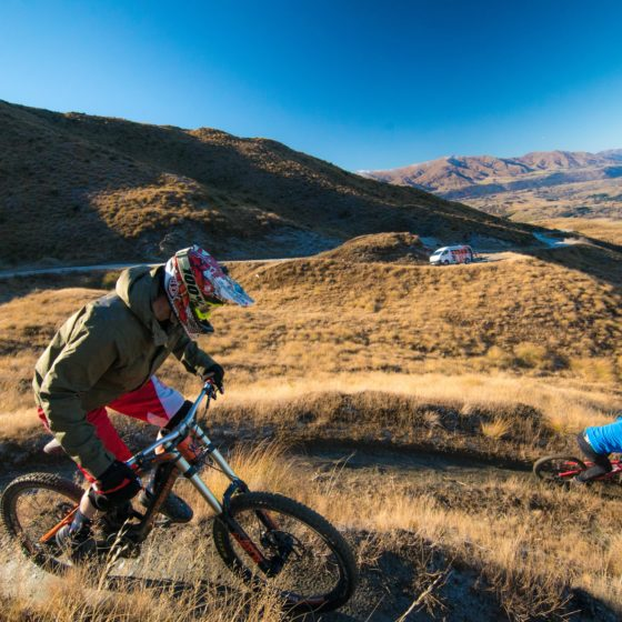 Queenstown Bike Taxis - Queenstown's Number 1 Mountain Bike Taxi Director Amy hooning down Zoot Trail Queenstown Otago New Zealand.