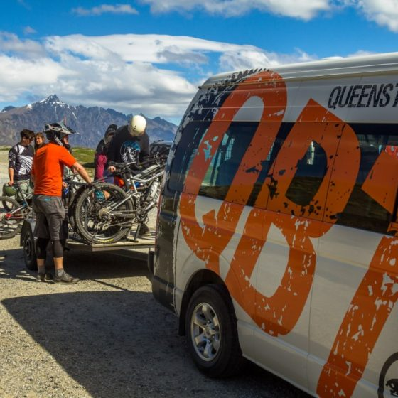 Riders loading bikes onto the shuttle van, Queenstown Rude Rock Trail