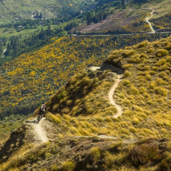 Riding ridgelines at Rude Rock, Queenstown, New zealand