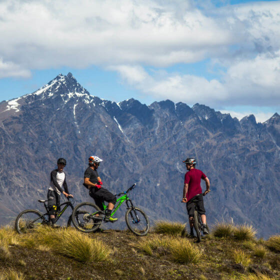 Bikers riding Queenstown mountain bike trail Rude Rock
